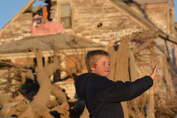 Zain Miller points to the direction the tornado which struck St. Elmo came from behind his home, which has now been judged uninhabitable.