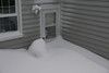 Our backdoor (with the barbecue under a mound of snow).