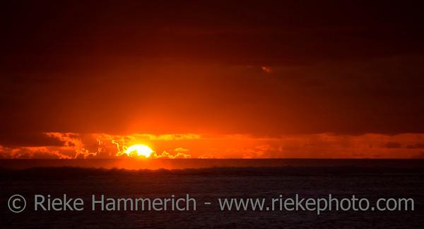 Sun sinks to Sea - Behind Coral Reef of Rarotonga, Cook Islands, Polynesia