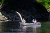 These fishermen are caught unaware as a sturgeon jumps from the Kennebec River in Augusta, Maine.