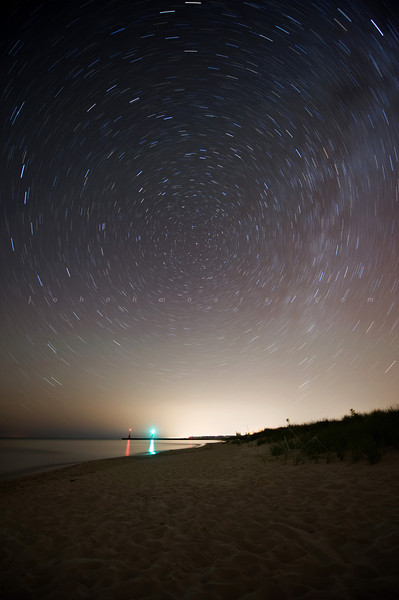 Star trails over channel markers.