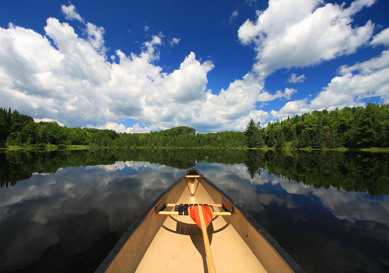 """ Canoeing In the Wild Blue Yonder "" Canoeing on a beautiful lake in Northern Wisconsin on a perfect day."