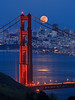 The supermoon rising over San Francisco skyline and Golden Gate Bridge