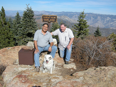 Sam, Sheila, and Norm on a glorious fall day atop Sunday Peak. The new summit register box has already had its lid attachment come apart, from wind or humans is not clear, so a rock is standing in for the hinges and latch.