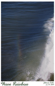 Wave Rainbow  A rainbow forming in the mist above a breaking wave.  Pismo Beach, California, 03 June 2009.