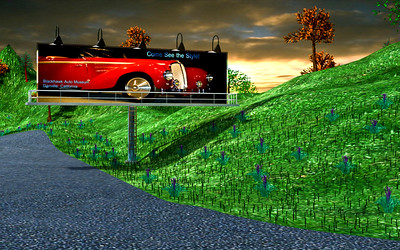 3DSMax Rendering of Billboard with Sunset.  THe picture of the car was taken by Aleck.  The backgrond is a stock photo.  The billboard, lights, trees, grass, etc are 3D constructs.