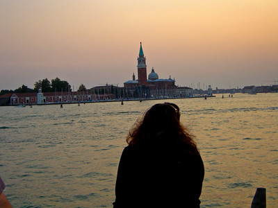 Venice sunset with woman.  Of all the pictures I have taken this remains one of my favorite.  There is a romantic and peaceful quality and at the same time sometimes I see it as a bit haunting.