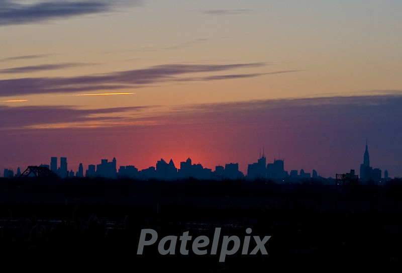 Waking up a city that (almost) never sleeps!<br /> <br /> Sunrise over Manhattan, as seen from the Meadowlands, New Jersey