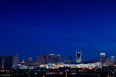 A photo I made of the Nashville skyline about 6:02 on a cold, Saturday morning in February 2013. The new Music City Center is the really long building with the undulating roof. Just to its right is a new hotel still under construction.