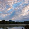 Sunrise illuminates the clouds over this lake near Marion, NC.