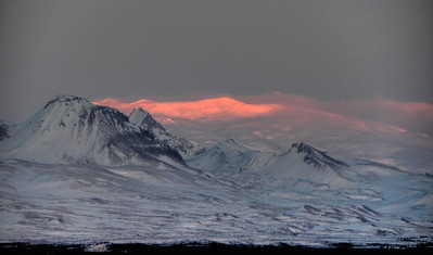 "A ""spotlight"" of alpenglow hits this ridge near Mt Wrangell, west of Glennallen, Alaska"