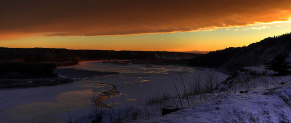 January 16, 2011:  Viewed from the Gakona overlook, the setting sun adds color to the otherwise drab winter landscape, with water vapor rising from open water channels in the frozen Copper River.