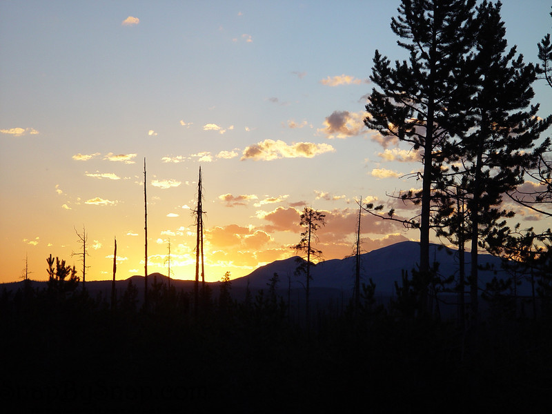Sun setting behind the mountains in Yellowstone National Park.