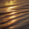 Waves reflecting the setting sun on the beach of Coronado Island.