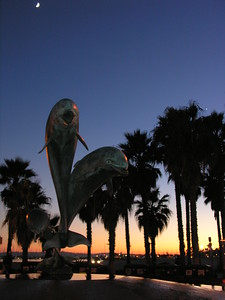 "© Joseph Dougherty.  All rights reserved.   Leaping dolphins smile as they rise above the waters of their fountain.    The entrance to Stearns Wharf is marked by Santa Barbara's Friendship Fountain. It was created by Bud Bottoms to honor the Chumash Indians and their close bond with the dolphins of the channel. The sculptor also cast similar fountains in Puerto Vallarta, Mexico and Toba City, Japan -- sister cities of Santa Barbara.  Hence the ""friendship fountain"" moniker."