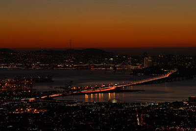 © Joseph Dougherty, All rights reserved.    Post-sunset colors linger over the Oakland waterfront, San Francisco Bay and the Bay Bridge.