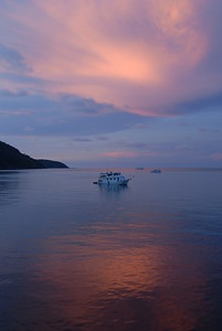 Liveaboard dive boats anchor for the night in the lee of the Similan Islands off the west coast of Thailand.