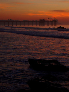 © Joseph Dougherty.  All rights reserved.   La Jolla shoreline and Scripp's Pier after sunset, with calm waves and low tide. San Diego County, California.