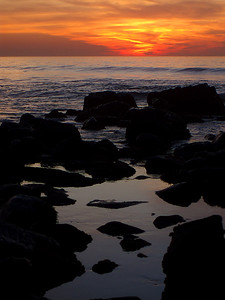 © Joseph Dougherty. All rights reserved.   La Jolla shoreline at sundown, with calm waves and low tide.