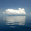 Large cumulus clouds coalesce above the Surin Islands; Andaman Sea, west of Thailand.