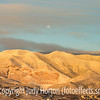 Rising Sun Strikes Snowy Front Range
