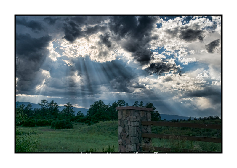 As we were driving home from dinner out last evening, the sun suddenly broke through some holes in the clouds and created this scene.  I hopped out of the car and quickly captured a few shots.  This is one of them.