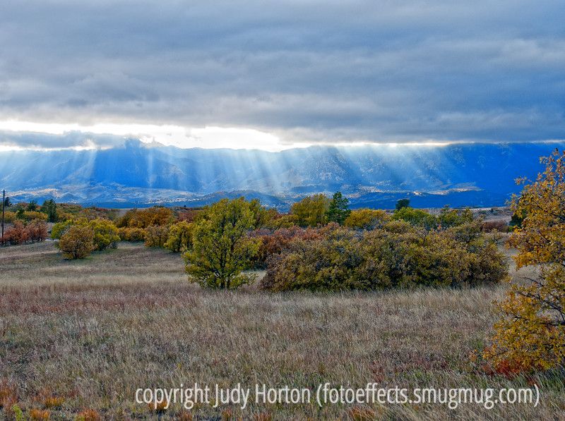 Rays of sunlight pour from the clouds over Colorado's Front Range