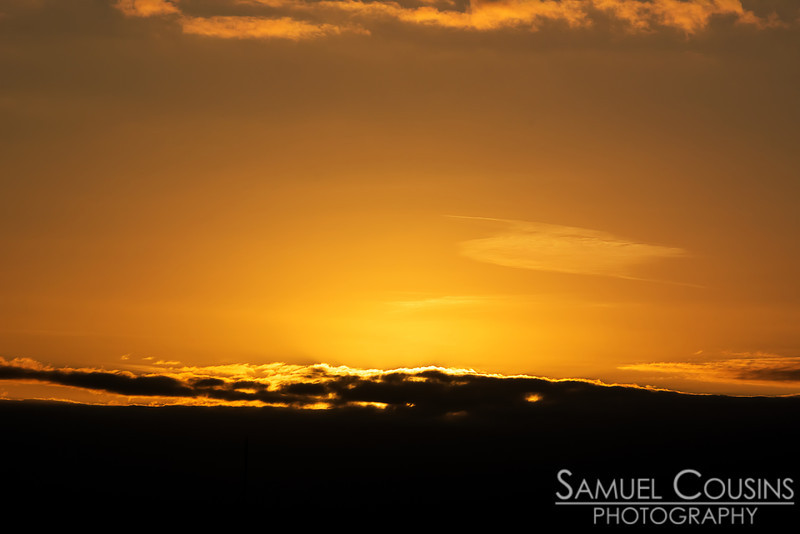 Sun hiding behind a cloud, a few minutes before sunset.