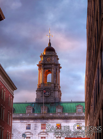 City Hall's bell tower at sunset.
