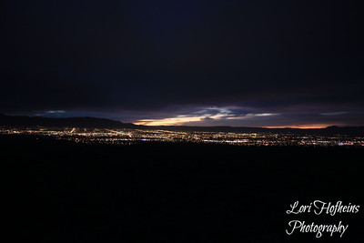 Sun Rising behind the Sandia's, facing downtown Albuquerque, NM