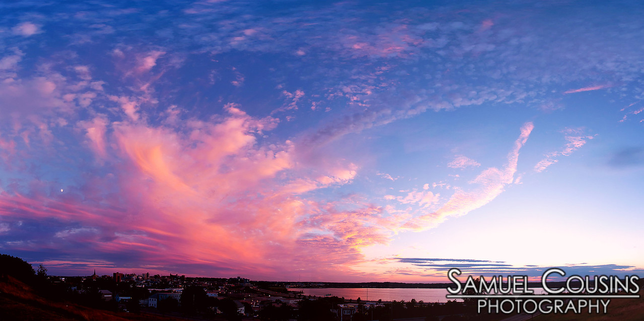 Sunset over Portland, Maine and Back Cove. Taken from Fort Sumner Park.  That bright white speck near the left side is the moon.