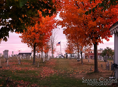 The Eastern Cemetery at sunset. The leaves on the trees have changed to their fall colors.