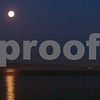 """A """"supermoon"""" sets over San Francisco Bay, as viewed from the shoreline of Berkeley, California, early Sunday, May 6, 2012. Photo by David Yee ©2012"""
