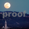 """A """"supermoon"""" rises over the Berkeley Hills in Berkeley, California, as viewed from Albany, Calif., on Saturday, May 5, 2012. The Campanile at the University of California is shown in the foreground. Photo by David Yee ©2012"""
