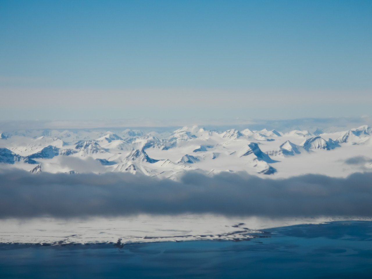 Spitzbergen , Svalbard from the air while flying south, June 2014