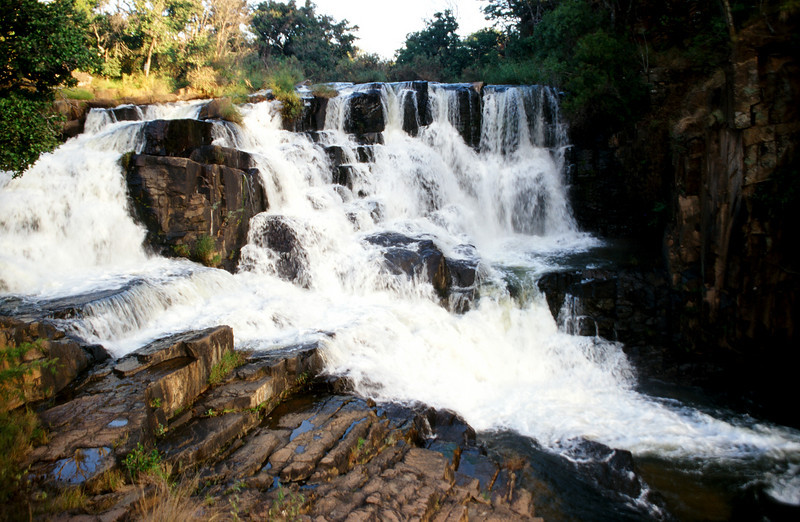 Nyanga Falls: The Eastern Highlands of Zimbabwe boast many waterfalls. These falls in Nyanga resembles a grand staircase down which the river tumbles with playful purpose.