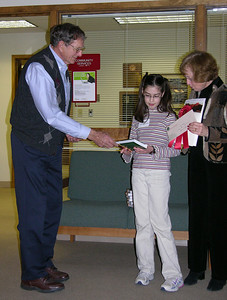 Marian Jackson presenting book to Emily Padgett, receiving 2nd Place in Youth Division from Gerri Varner