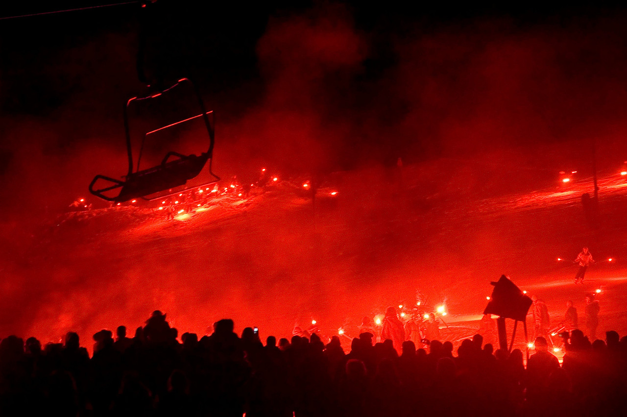 The 58th Annual Tahoe Torch Festival; hundreds of skiers coming down the mountain with flares.