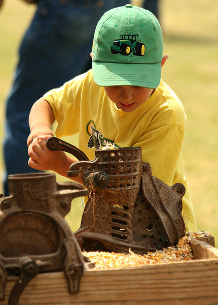 Corn grinding at the annual Early Days show.