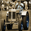 "Tractor parade at the annual Early Days event. Named for the town of Plymouth, Ohio, this tractor eventually was forced to change its name due to a legal battle with Chrysler who produced the Plymouth automobile. The tractor became the ""Silver King"" in the mid 1930's."