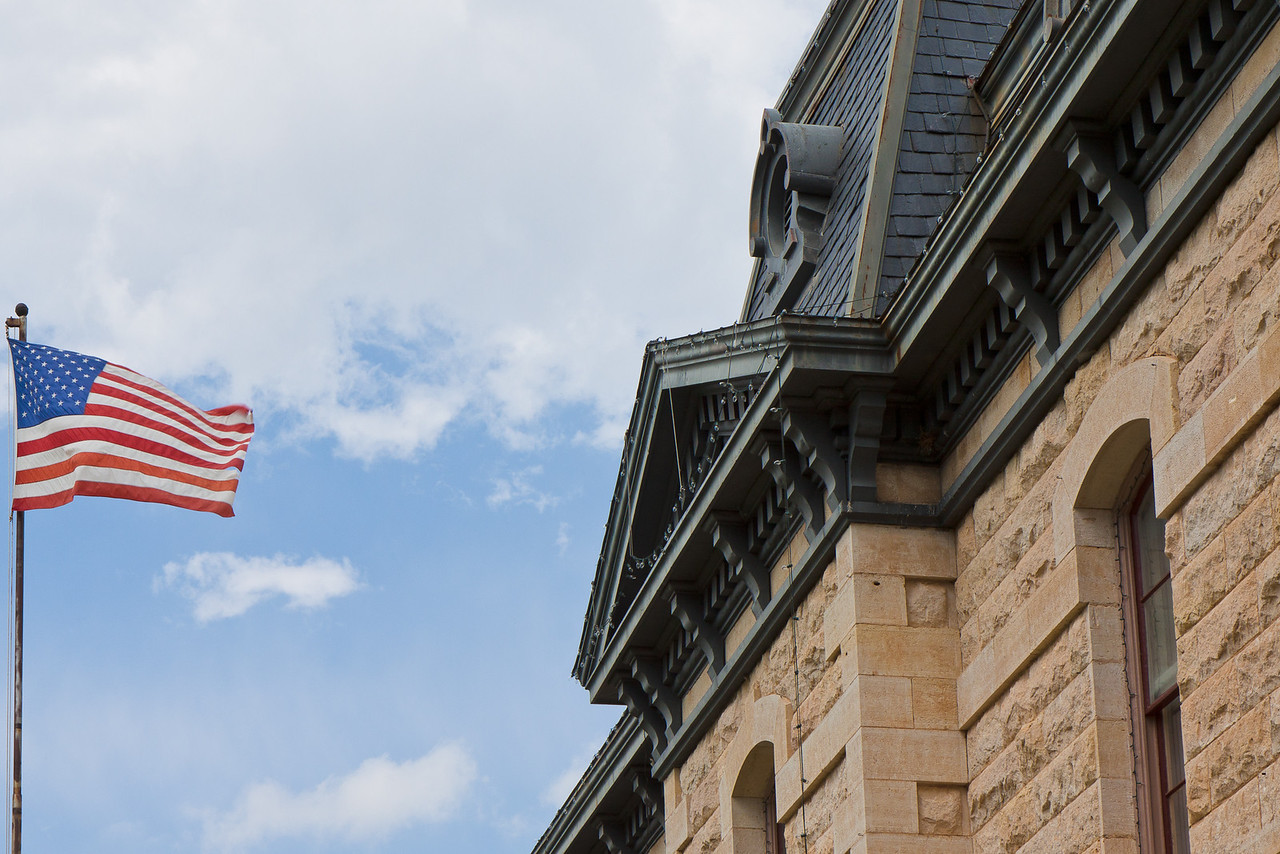 Stars and stripes flying at the Old Blanco County Courthouse.