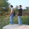 Nathan, Me, Overlooking Lake <br /> Guns in Hand.