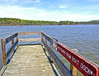 The same view from the dock 2 years later after the rains have filled the lake up to the needed levels to operate.