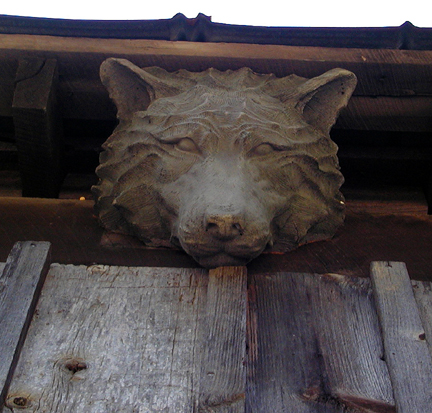 Who's afraid of the big bad wolf?<br /> Wolf staring down from the eaves of The Lily Barn.<br /> Townsend, TN.