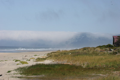 Cloud descending over the rocks - Newport, Oregon