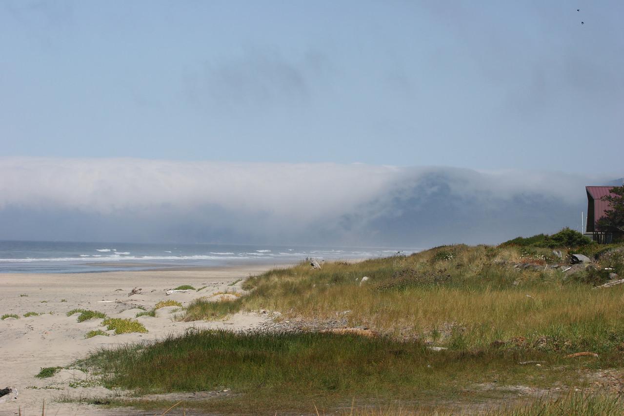 Cloud descending over the rocks - Newport, Oregon