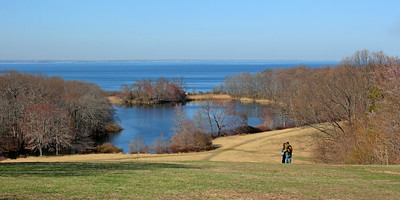 Young couple kissing by fresh water pond in Caumsett State Park