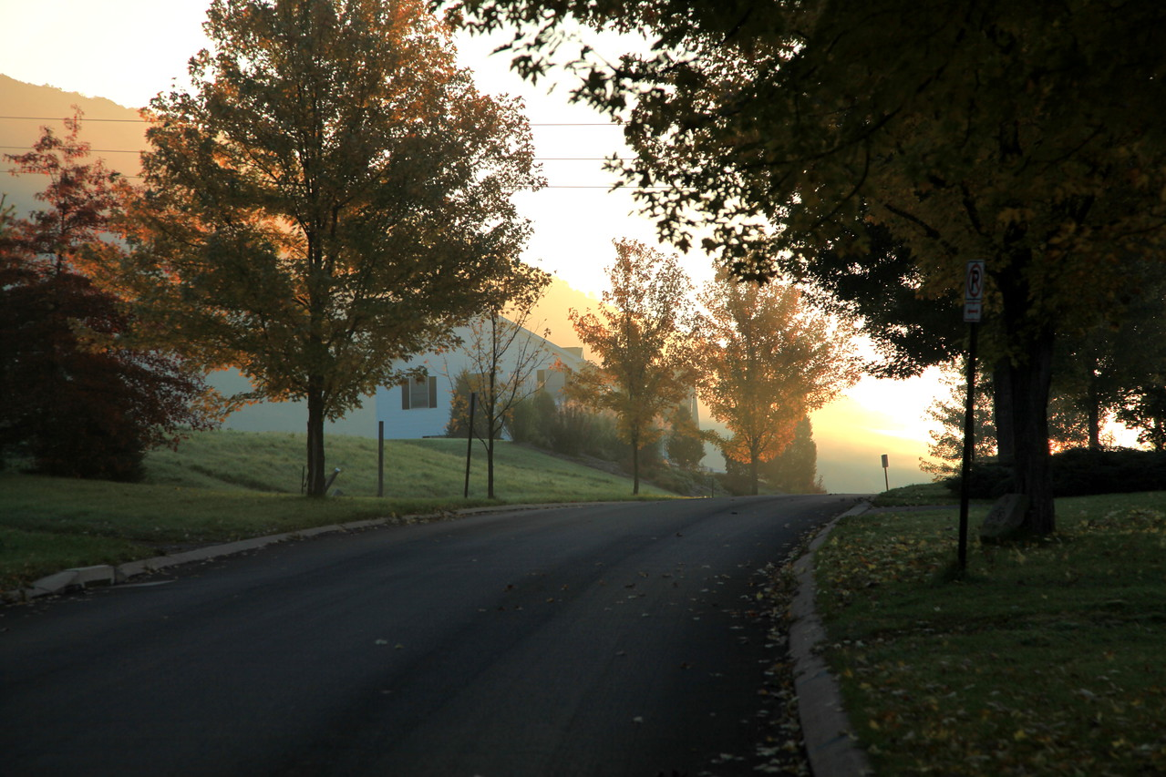 Looking up our street at a sunrise over Mt. Nittany.