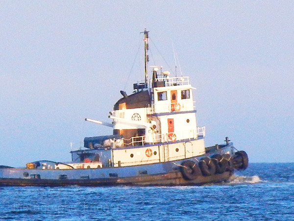 Tug Boat going Out To Help