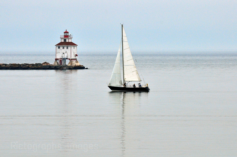 Sailboat, Lighthouse and Breakwater Thunder Bay, Ontario, Canada,  Harbour